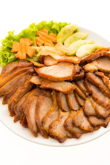 Roasted bbq red pork with sweet sauce in chinese food style in white plate