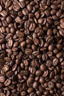 Roasted beans of tasteful coffee background