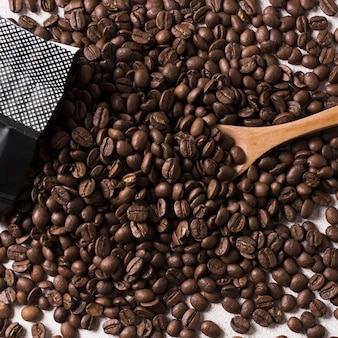 Roasted beans of tasteful coffee and spoon