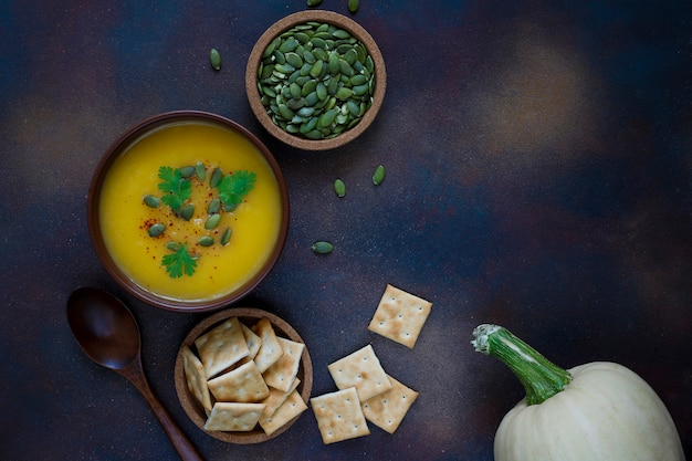 Roasted butternut squash cream soup with pumpkin seeds