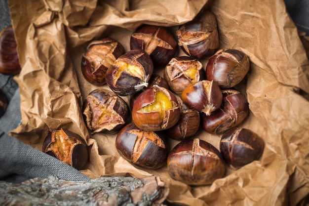 Roasted chestnuts on paper.