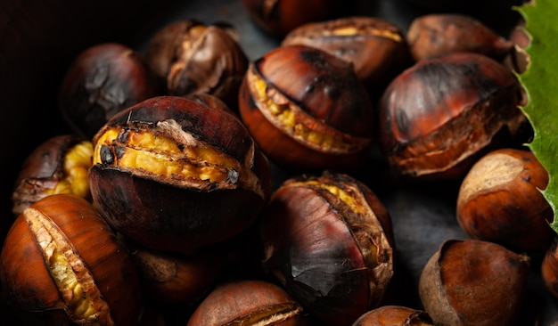 Roasted chestnuts in a pitted pan