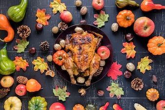 Roasted chicken between vegetables and fruits