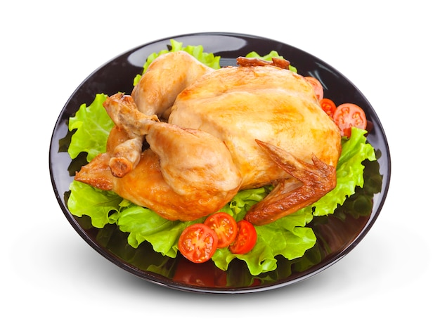Roasted chicken on black plate
