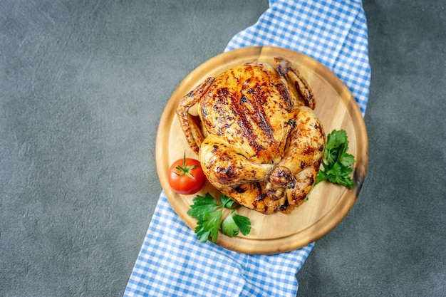 Roasted chicken on grey rustic table