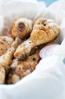 Roasted chicken legs with red onion