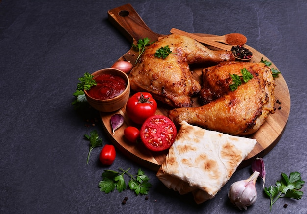 Roasted chicken legs with spices and vegetables
