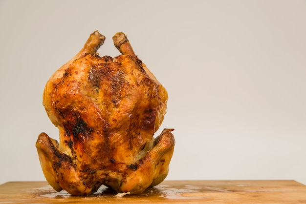 Roasted chicken standing on table