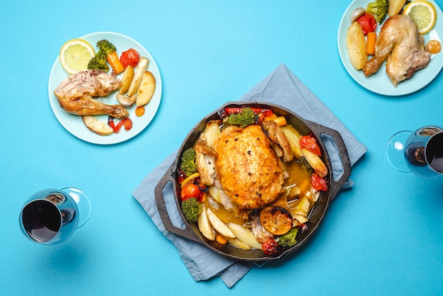 Roasted chicken and wine glasses