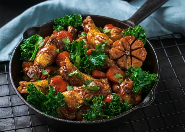 Roasted chicken wings with carrots, kale, garlic and dipping sauce.