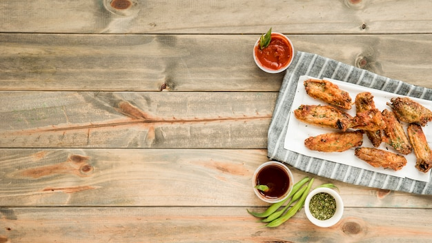 Roasted chicken wings with various savoury sauces