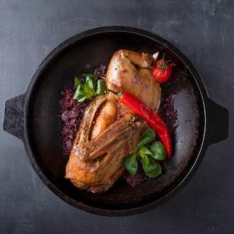 Roasted chicken with red sauerkraut. top view
