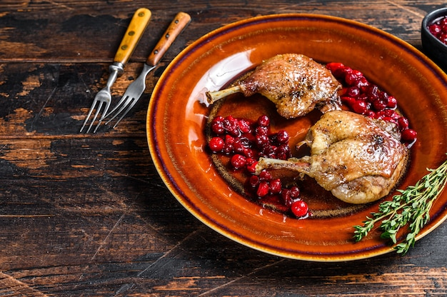 Roasted christmas duck legs with cranberrie sauce
