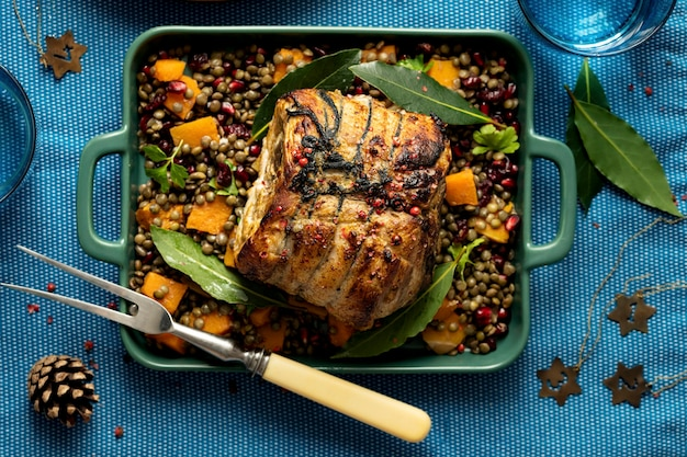 Roasted christmas ham with pomegranate and lentils food photography