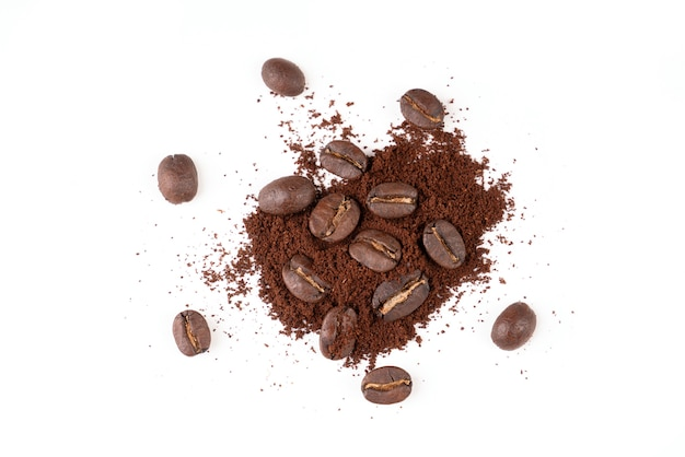 Roasted coffee bean with powder on white
