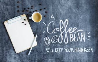 Roasted coffee beans and coffee on the clipboard with text on the chalkboard