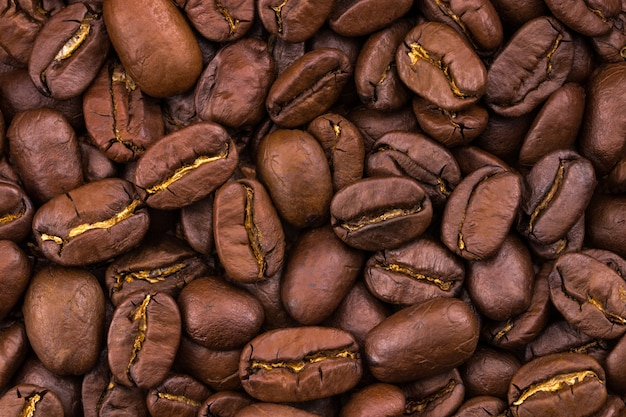 Roasted coffee beans background. close up. texture
