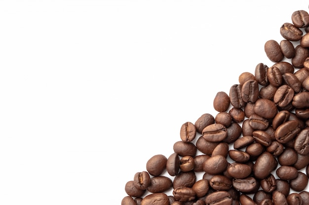 Roasted coffee beans for background with copy space area for text.