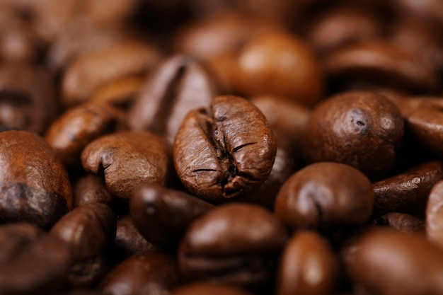 Roasted coffee beans background with focus foreground