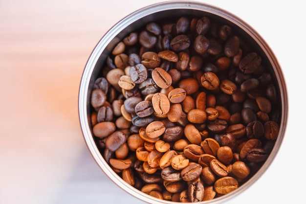 Roasted coffee beans in a bowl, top view