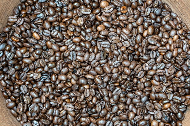 Roasted coffee beans in a clay pot in the local market, bali, indonesia. close up, top view