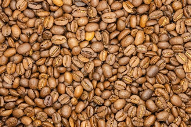 Roasted coffee beans, close up, macro.