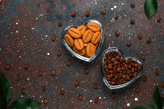 Roasted coffee beans and coffee bean shaped cookies