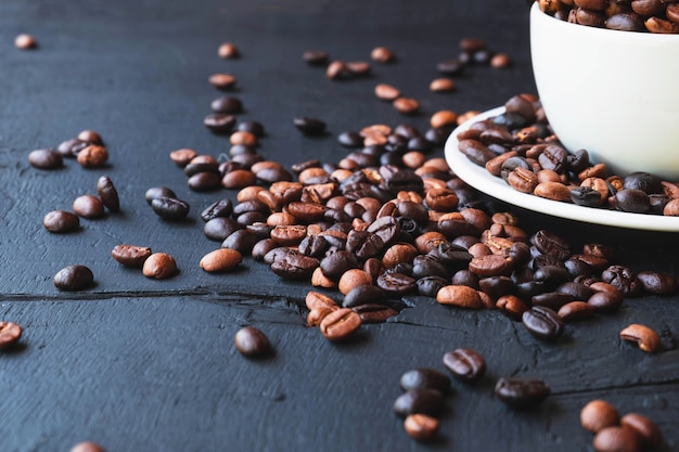 Roasted coffee beans in a cup of coffee
