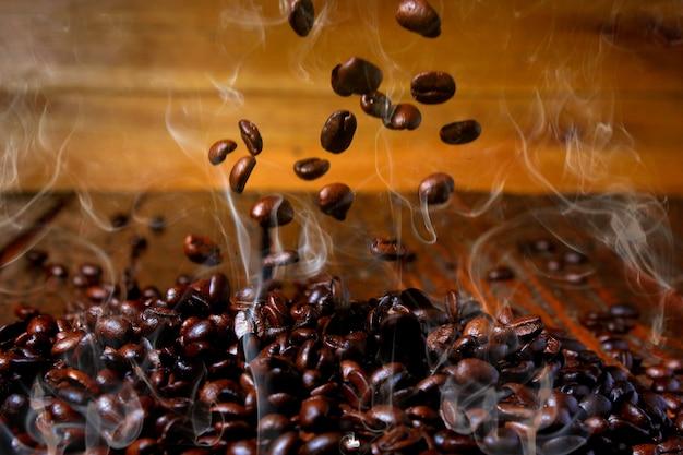 Coffee Beans With Smoke On White Background Photo Premium