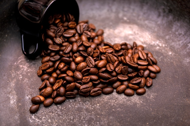 Roasted coffee beans in hearth shape.
