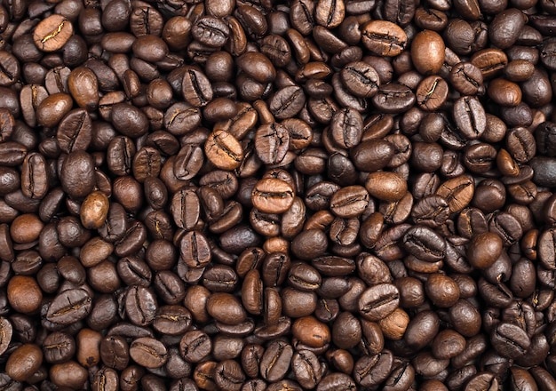 Roasted coffee beans texture background, closeup