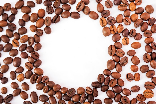 Roasted coffee beans with copy space on white background