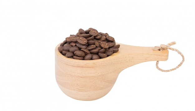 Roasted coffee beans in wood bowl isolated on white