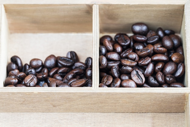 Roasted coffee beans in wooden box