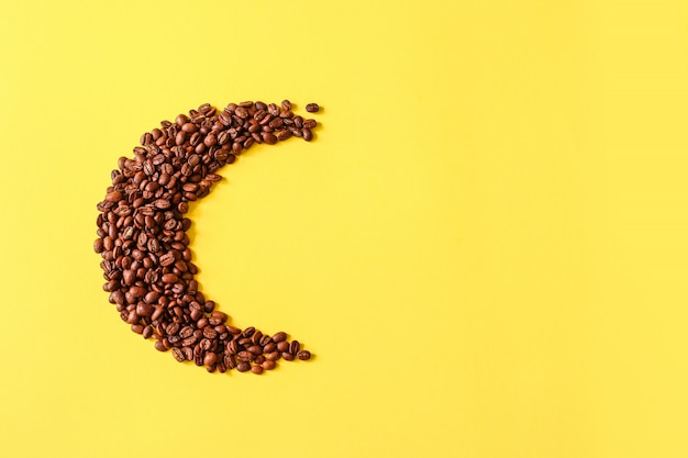 Roasted coffee grains lying in the shape of the moon