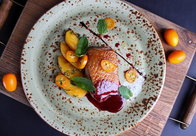 Roasted duck breast with kumquat apple and berry sauce