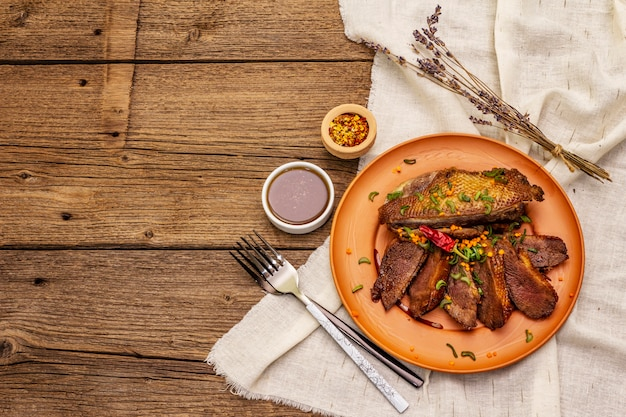 Roasted duck breasts, spices and demi-glace sauce. traditional french food
