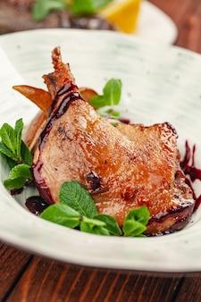Roasted duck leg steak with orange sauce
