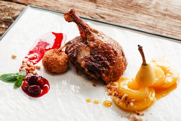 Roasted duck leg with pear