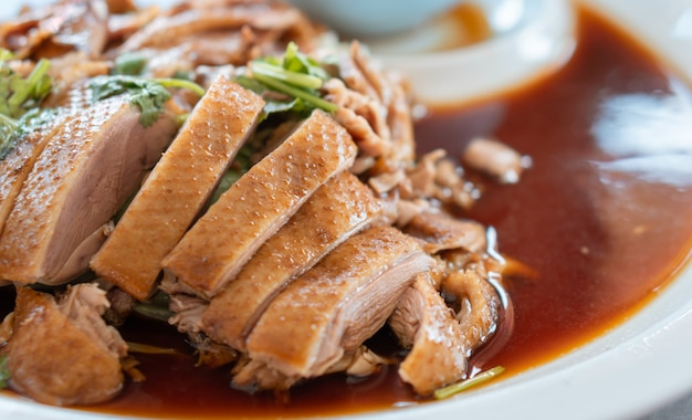 Roasted duck in thai style for chinese new year dinner meal,