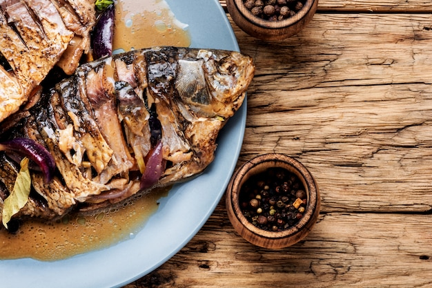 Roasted fish on wooden table