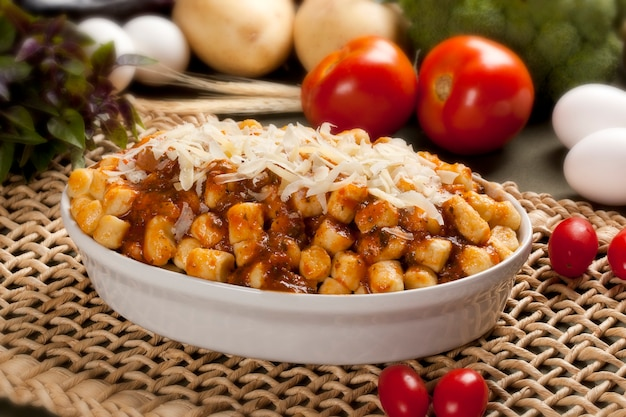 Roasted gnocchi with tomato souce, parmesan cheese and herbs.