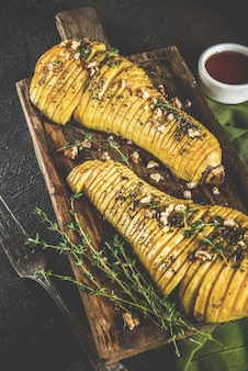 Roasted hasselback pumpkin with herbs