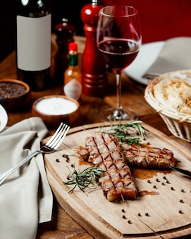 Roasted meat with glass of wine
