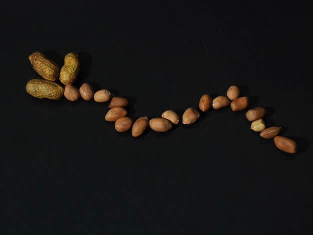 Roasted peanuts on a black background