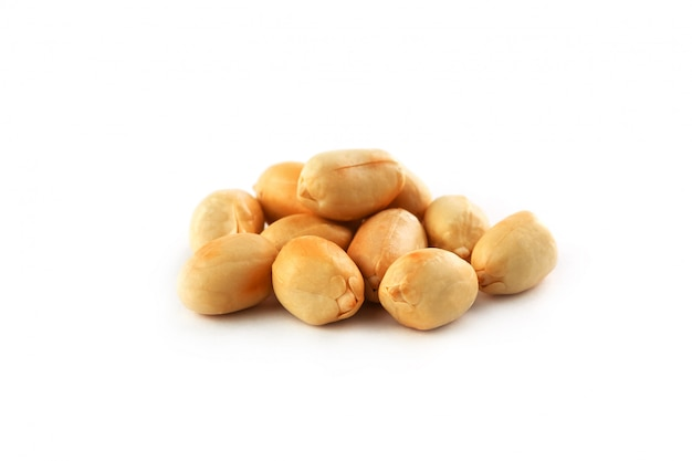 Roasted peanuts peeled and isolated on a white background