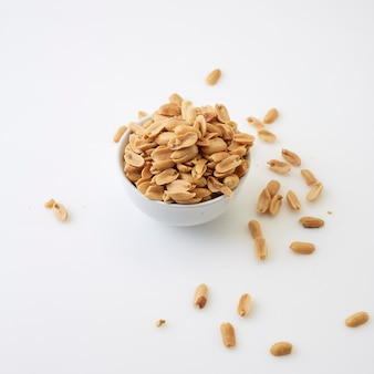 Roasted peanuts and salt in a bowl