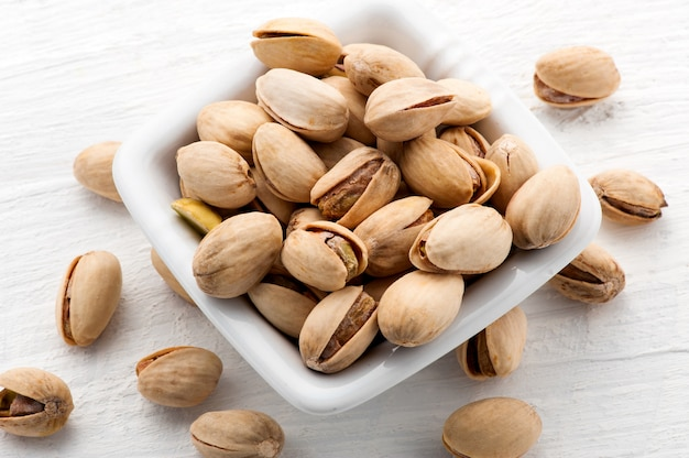 Roasted pistachio nuts in a square bowl