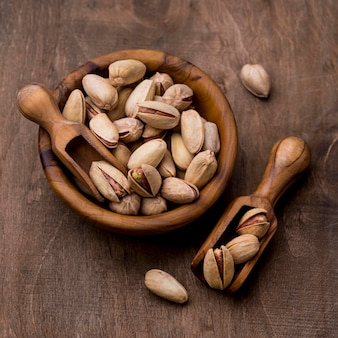 Roasted pistachio nuts in wooden bowls