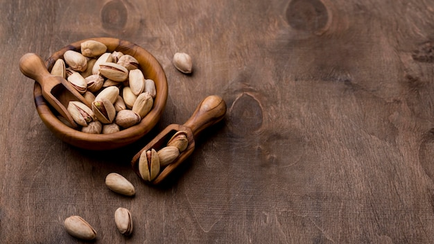 Roasted pistachio nuts on wooden table